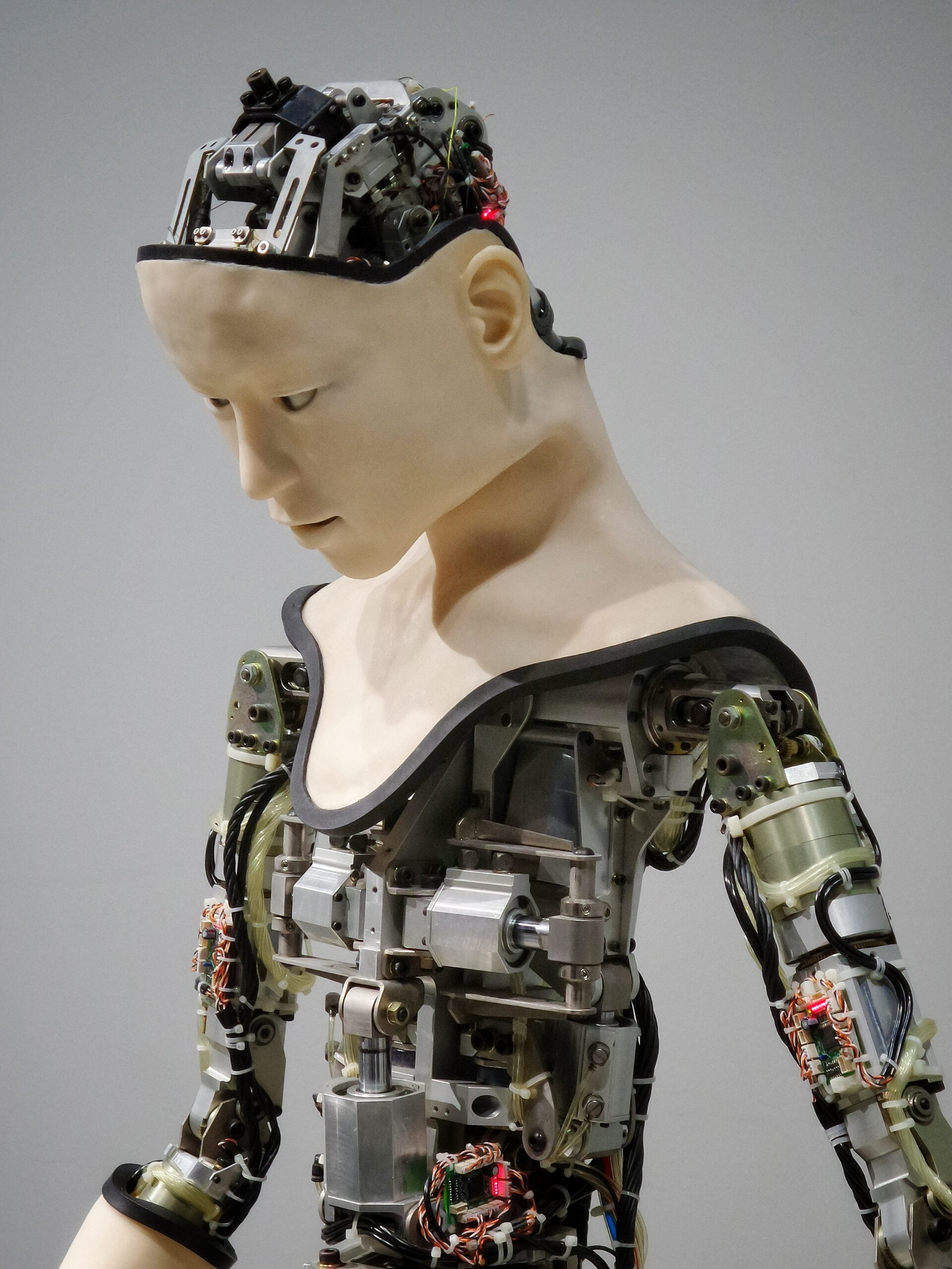 Image shows humanoid robot looking downward. Are sex robots the wave of the future?