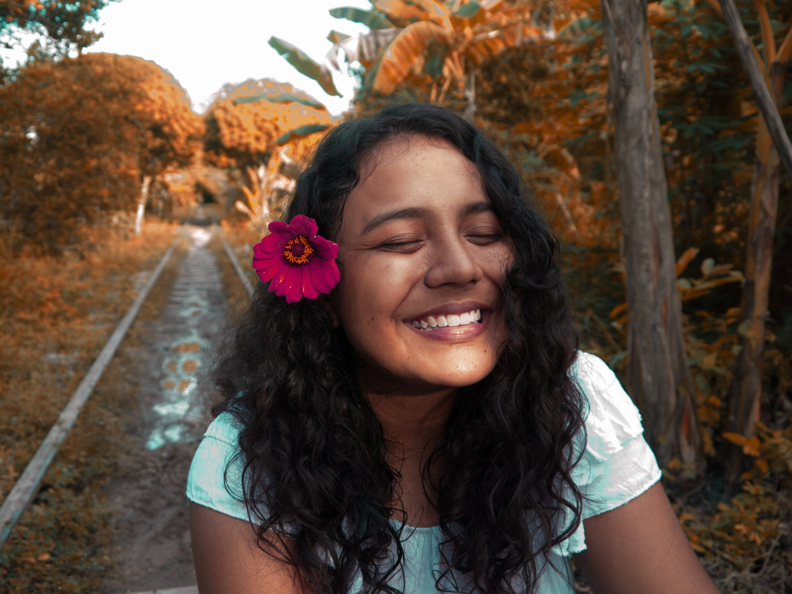 Image shows smiling girl with flower in her hair, wondering about correct terminology for her genitalia