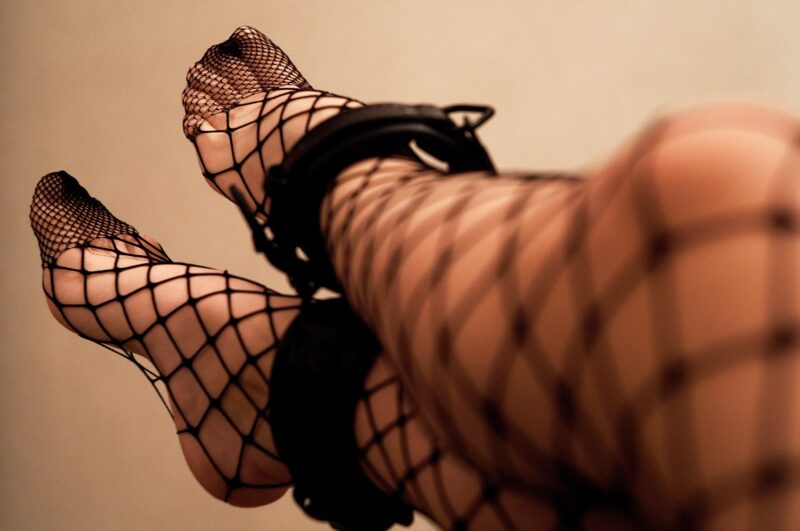 person-practices-bdsm-by-wearing-ankle-cuffs