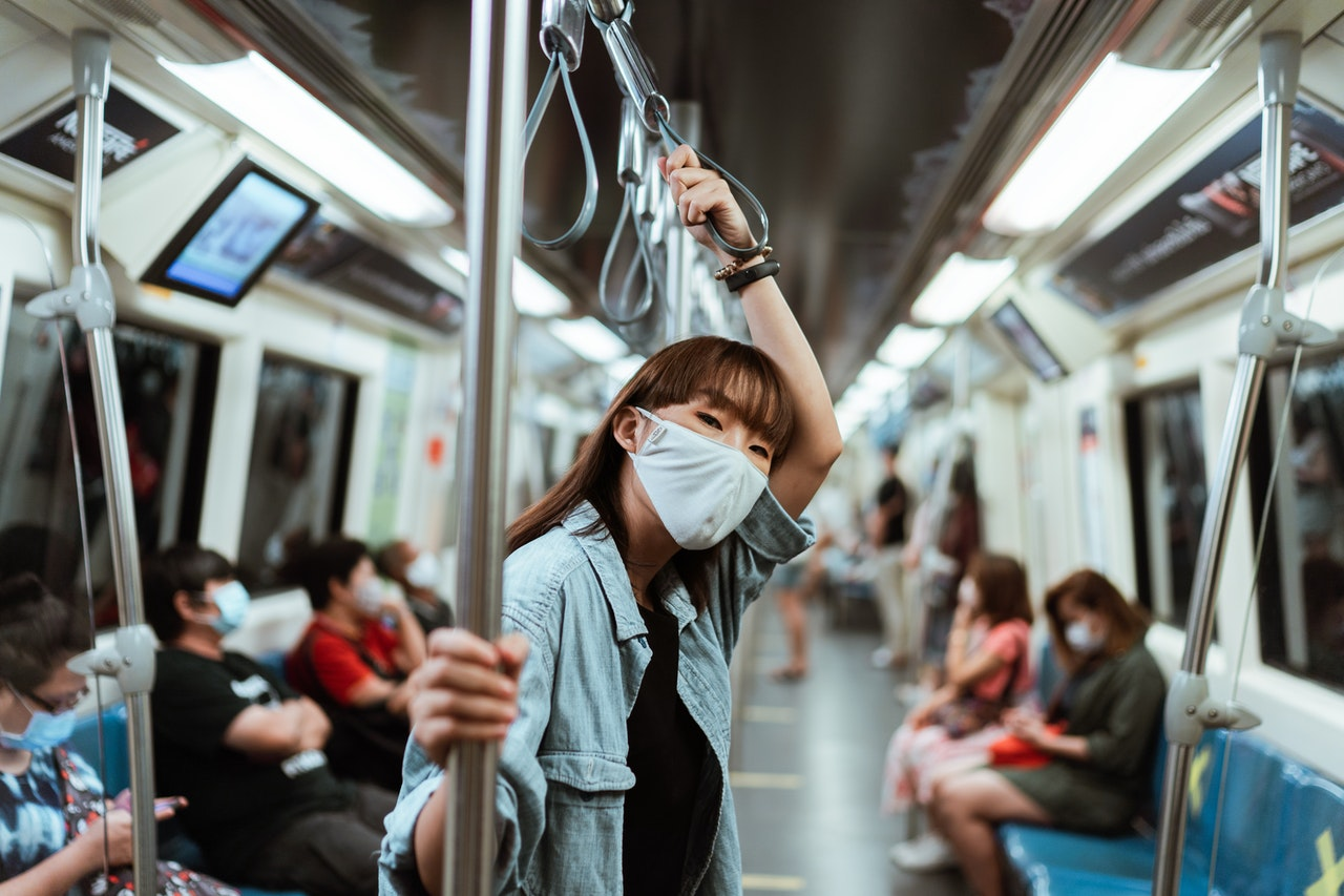 masked woman on the train navigating dating during covid-19 era