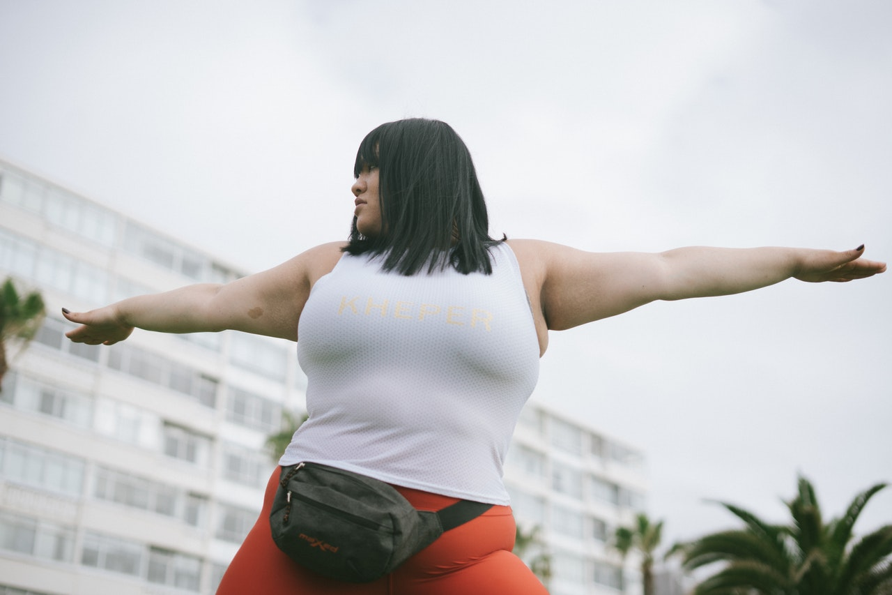 a woman in athletic gear combining fitness training with sex coaching